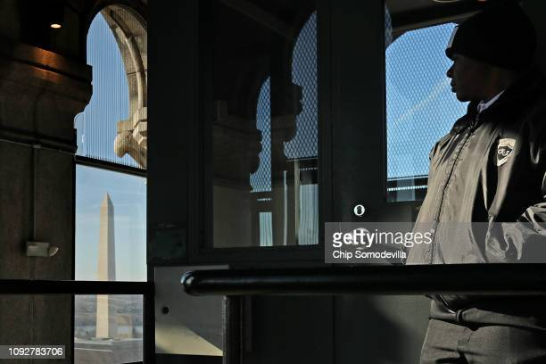 A security guard stands guard on the observation deck of the Old Post Office Tower January 11 2019 in Washington DC While thousands of National Park...