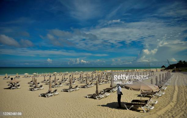 Security guard stands in an empty beach at the Melia Varadero International Hotel in Matanzas Province, on October 23, 2020. - Varadero, Cuba's most...