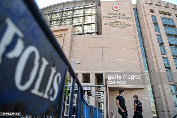 Security guard stands in front of Istanbul's court house on July 3, 2020 during the trial of 20 saudi suspects accused in the murder of journalist...