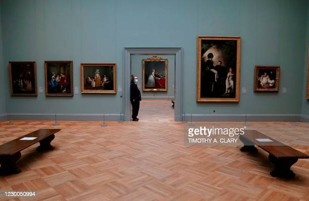 """Security guard stands in the doorway during a press viewing of """"A New Look at Old Masters"""" a newly installed gallery for European Paintings, on..."""