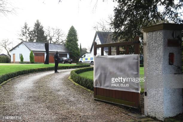 A security guard stands in the driveway where a Cheshire Police Crime Scene Investigation van has parked at the home of Manchester United executive...