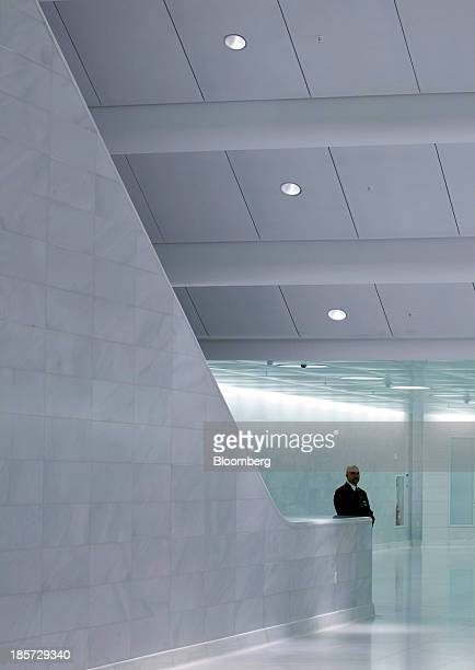 A security guard stands in the West Concourse at the World Trade Center site in New York US on Thursday Oct 24 2013 The 600foot long passageway links...