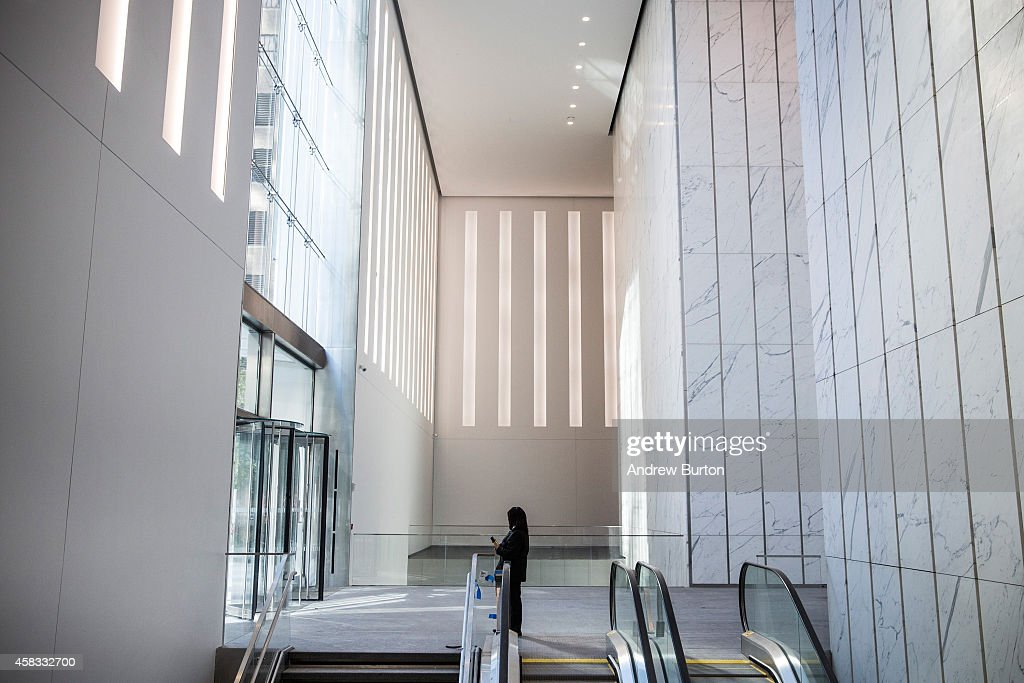 A security guard stands inside One World Trade Center, which opens today, on November 3, 2014 in New York City. The skyscraper is 104 stories tall and cost $3.9 billion; it opens more than 13 years after the terrorist attacks of September 11, 2001, destroyed the original World Trade Center buildings. Officials say the building is currently at 60% occupancy, with Conde Nast as one of the first major tenants to move in.