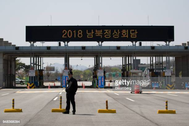 A security guard stands near a toll gate at the Customs Immigration and Quarantine office near the demilitarized zone in Paju South Korea on...