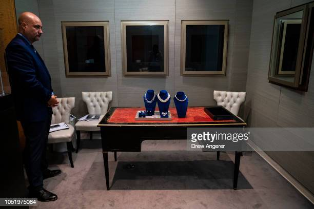A security guard stands near jewelry worn by French Queen Marie Antoinette while it is displayed at Sotheby's auction house October 12 2018 in New...