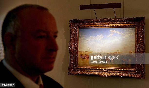 A security guard stands near JMW Turner's masterpiece 'Giudecca La Donna della Salute and San Giorgio' at Christie's auction house on November 21...