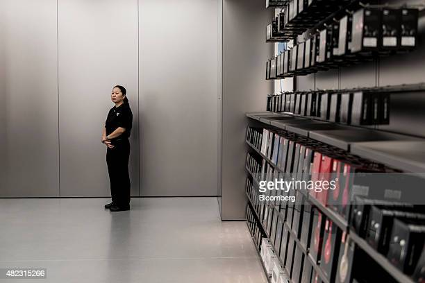 A security guard stands near products on display at Apple Inc's new Canton Road store in the Tsim Sha Tsui district of Hong Kong China on Thursday...