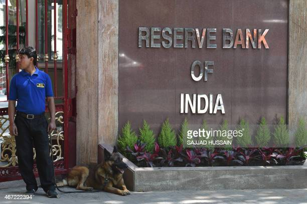 A security guard stands near the main gate of the Reserve Bank of India office during a meeting by Indian finance minister Arun Jaitley with the...