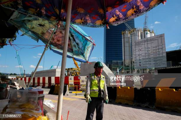 A security guard stands near the under construction Exchange 106 building on the site of the Exchange TRX precinct in Kuala Lumpur Malaysia on...