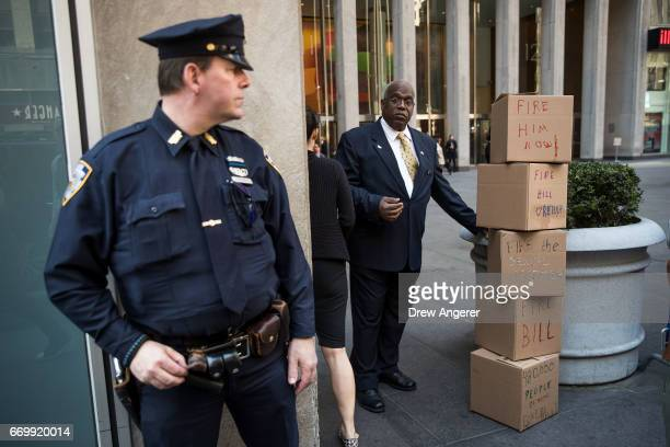 A security guard stands next to boxes of petitions left by protestors calling for the firing of Fox News television personality Bill O'Reilly in...