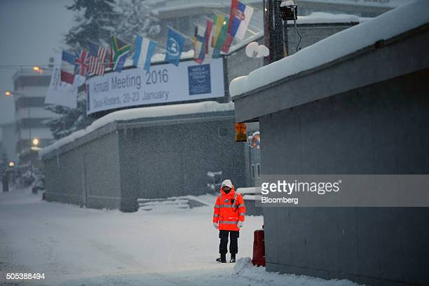 Security guard stands on duty outside the Congress Center venue for the World Economic Forum in Davos, Switzerland, on Saturday, Jan. 16, 2016. World...