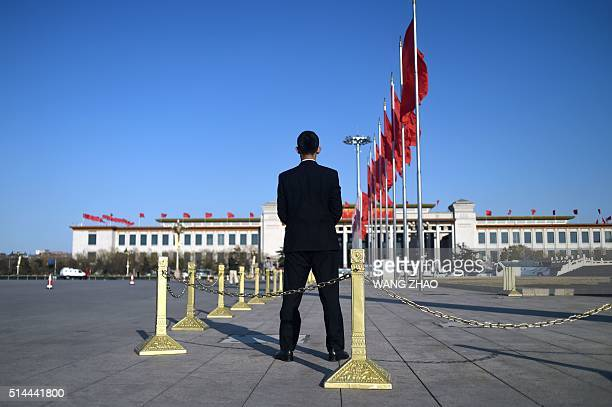 A security guard stands on Tiananmen Square during the 2nd plenary session of the National People's Congress at the Great Hall of the People in...