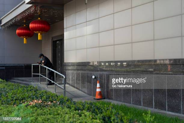 Security guard stands outside of the Chinese consulate after the United States ordered China to close its doors on July 22, 2020 in Houston, Texas....