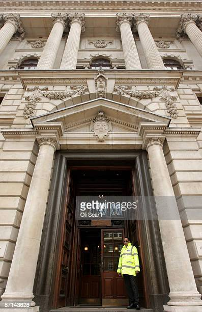 A security guard stands outside of the Government department of 'HM Revenue and Customs' in Westminster on May 8 2009 in London England