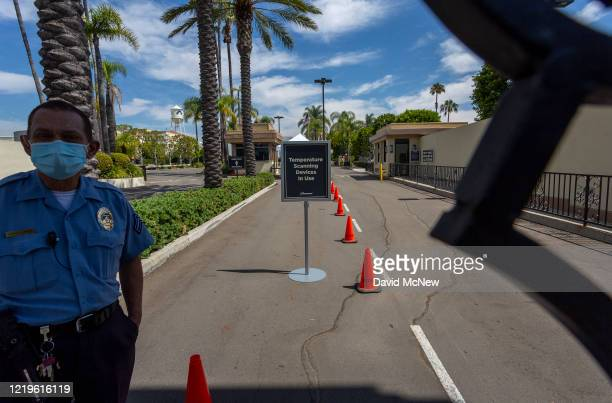 Security guard stands outside Paramount Pictures Studios as Los Angeles County allows more businesses and facilities to reopen today, despite rising...