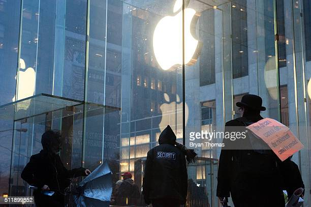 A security guard stands outside the Apple store on 5th Avenue on February 23 2016 in New York City Protestors gathered to support Apple's decision to...