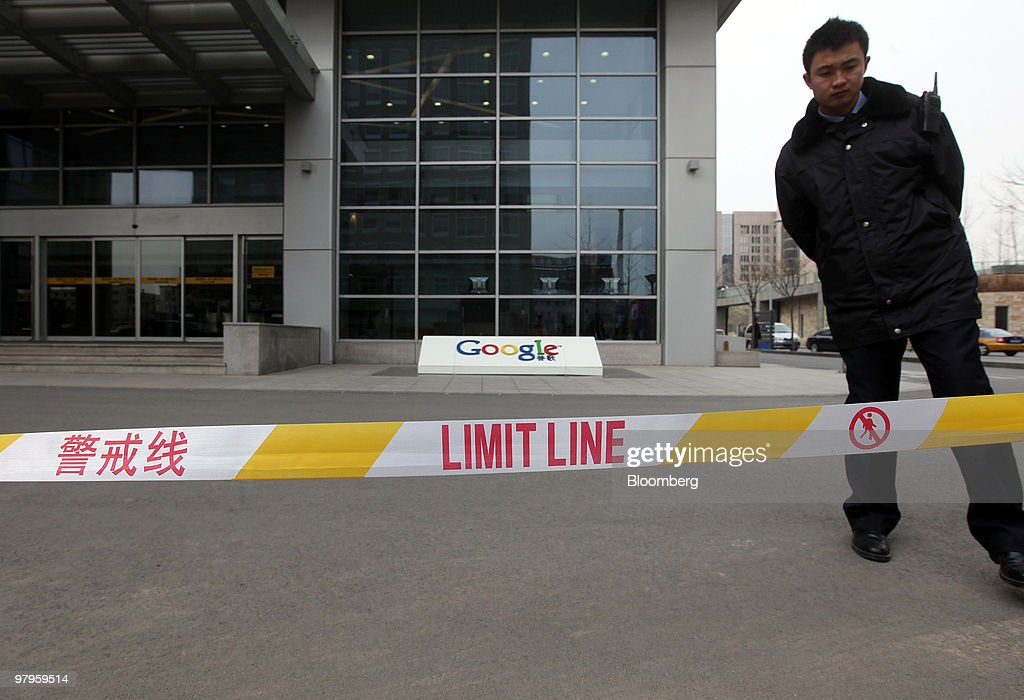 A security guard stands outside the Google Inc. offices in Beijing, China, on Tuesday, March 23, 2010. Google Inc., following through on a pledge to stop censoring search results in China, began serving mainland Chinese users via its unfiltered Hong Kong site, a move that could prompt the government to block the service. Photographer: Doug Kanter/Bloomberg via Getty Images