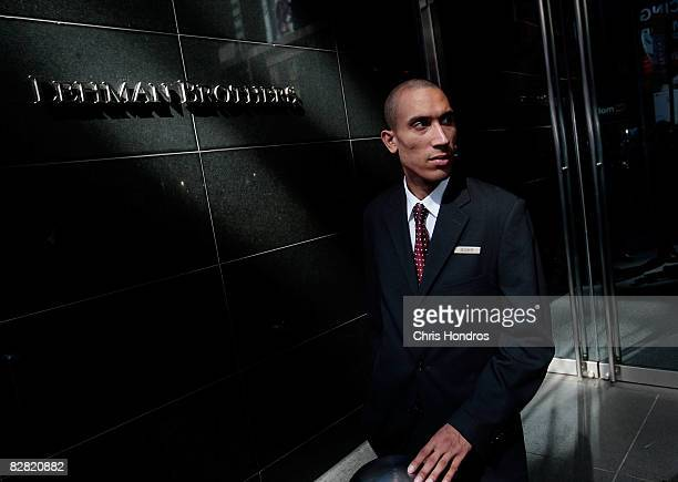 A security guard stands outside the headquarters of the financial firm Lehman Brothers Holdings Inc September 15 2008 in New York City Lehman...