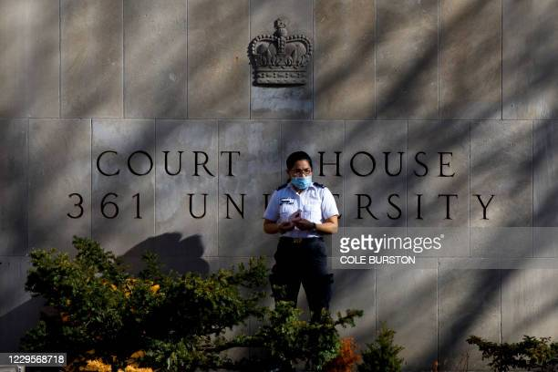 Security guard stands outside the Superior Court of Justice in Toronto, Ontario, Canada on November 10 during the first day of the trial for accused...