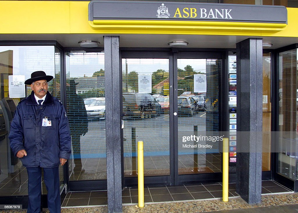 A security guard stands outside the Three Kings branch of the ASB