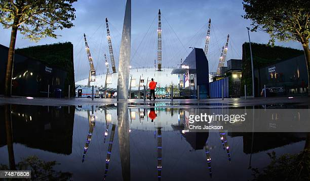A security guard stands watch on as the lights are lit on the newly branded O2 Arena on June 24 2007 in London England The Arena is owned by AEG has...