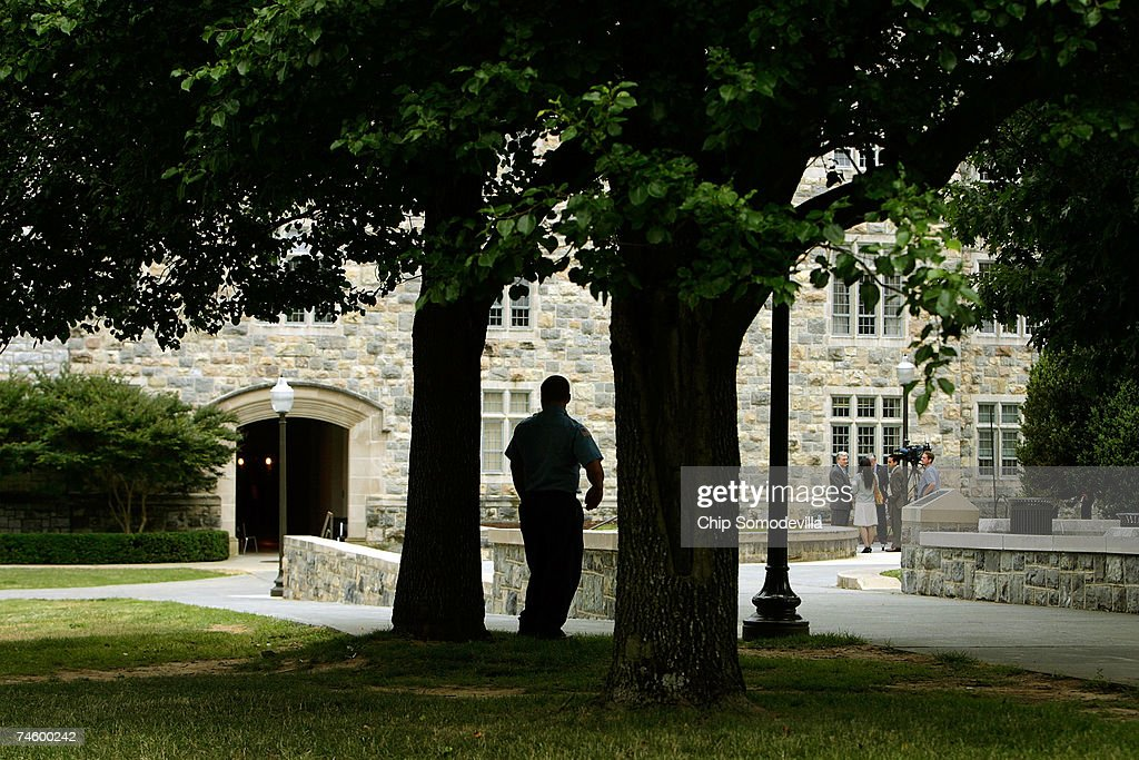 A security guard stands watch outside Norris Hall ahead of the building's phased re-use on the campus of Virginia Tech June 14, 2007 in Blacksburg, Virginia. On April 16, 2007, Virginia Tech undergraduate student Hsung-wei Cho went on a shooting rampage on the second floor, killing 30 of his 32 victims while they were attending or teaching engineering and language classes in Norris Hall. Virginia Tech President Charles Steger said the June 18 reopening of Norris Hall is the best way for the College of Engineering and the Department of Engineering Science and Mechanics to heal and move forward. No general assignment classes will be held in Norris, but the 70,000-square-foot building will be used for offices and laboratories. The classrooms where the shootings happened will remain closed.
