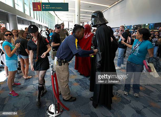 A security guard stops and inspects Star Wars villain Darth Vader played bySteve Gwin of Modesto a member of the worldwide 501st Legion costume...