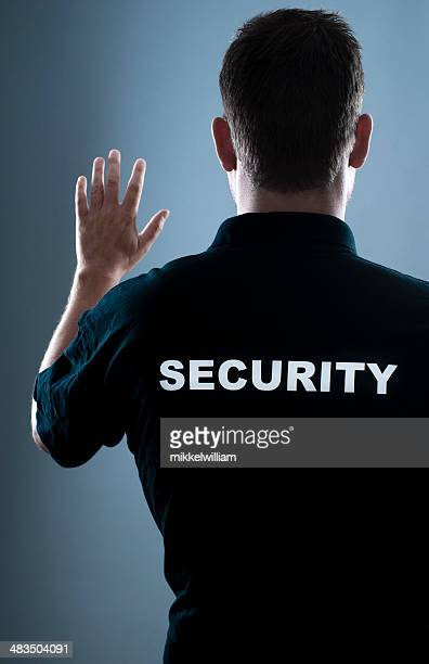 security guard stops people - doorman stock photos and pictures