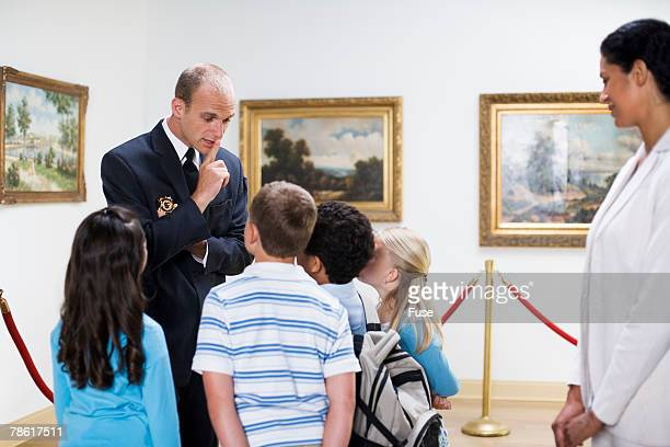 Security Guard Talking to Elementary Students in Art Gallery