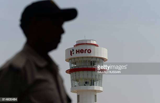 A security guard walks near a watchtower during the inauguration of the auto giant Hero's new 'Centre of Innovation and Technology' facilities on the...