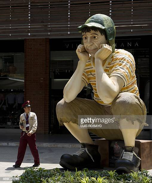 A security guard walks next to a commemorative sculpture of famous Latin American TV character El Chavo del Ocho starred by Mexican artist Roberto...