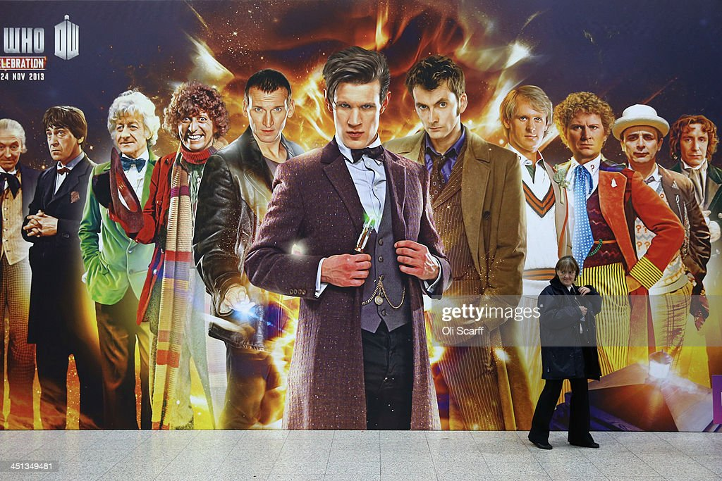 A security guard walks past a giant Doctor Who poster at the 'Doctor Who 50th Celebration' event in the ExCeL centre on November 22, 2013 in London, England. The sold-out three day event in the ExCeL London convention centre celebrates 50 years of the show which has seen 11 actors play the role of Doctor Who and receives a worldwide cult following.