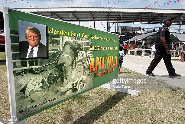 A security guard walks past an advertisement welcoming people to the Angola Prison Rodeo at the Louisiana State Penitentiary April 23 2006 in Angola...