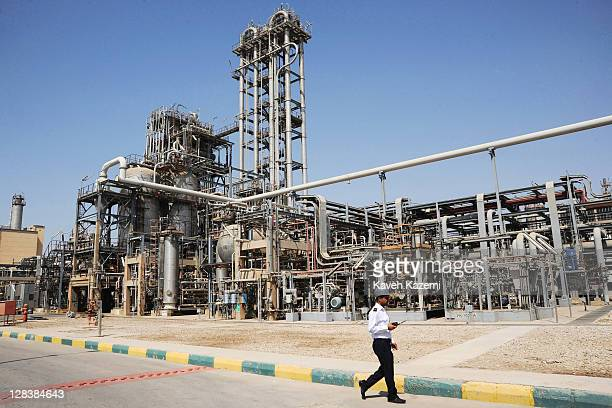 A security guard walks past installations in Marun petrochemical plant on September 28 2011 in Mahshahr Khuzestan province southern Iran Iran seeks...