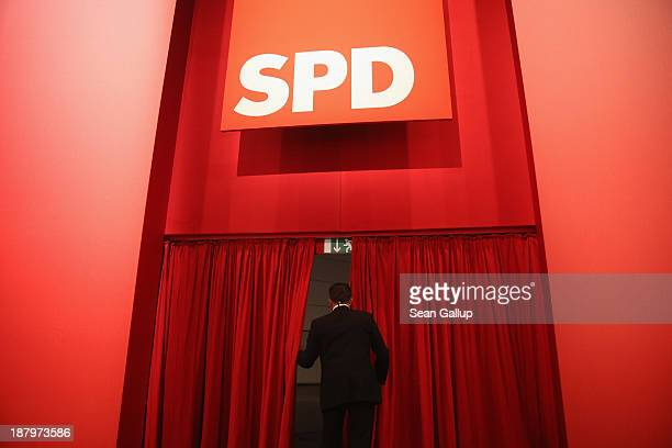 A security guard walks through a curtain to where leading party members were arriving at the federal party convention of the German Social Democrats...