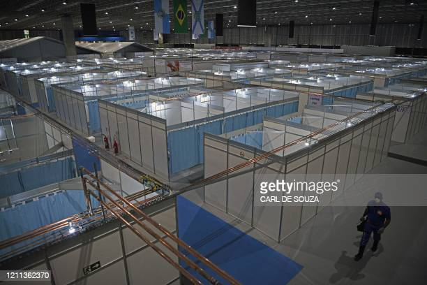 Security guard walks through the corridors of the Riocentro field hospital which was set up to receive COVID-19 coronavirus patients, in Rio de...