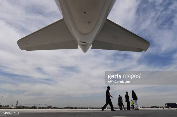 A security guard walks under the first Airbus A330 plane to be delivered after the inauguration ceremony of the Airbus Long Range Cabin Completion...