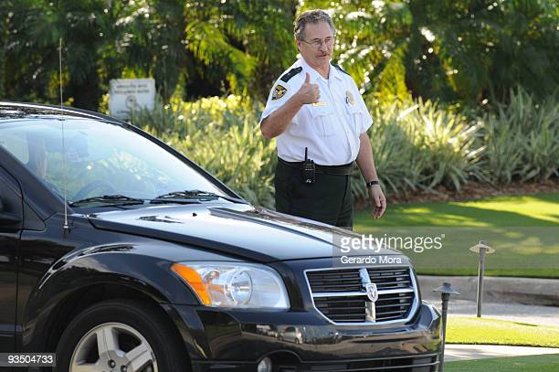 A security guard watches from the gate of the Isleworth community which is home to Tiger Woods on November 30 2009 in Windermere Florida Tiger Woods...