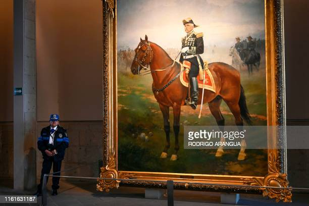 A security guard watches next to a painting depicting late Mexican President Porfirio Diaz in Chapultepec castle at Chapultepec Park in Mexico City...