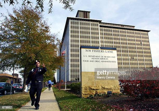 A security guard watches the vicinity around the US Department of Health and Human Services and the Food and Drug Administration November 1 2001 in...