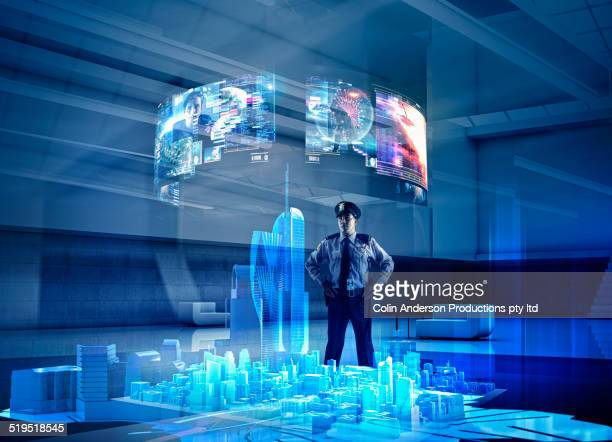 security guard watching virtual screens over city - hologram stock pictures, royalty-free photos & images