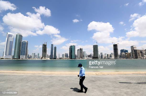A security guard wearing a protective facemask is seen on March 24 2020 in Sharjah United Arab EmiratesOn March 11 the World Health Organization...