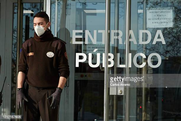 Security guard wears a protective face mask at the Trial Court on March 13, 2020 in Madrid, Spain. Today known cases of Covid-19 in Madrid are 2 this...