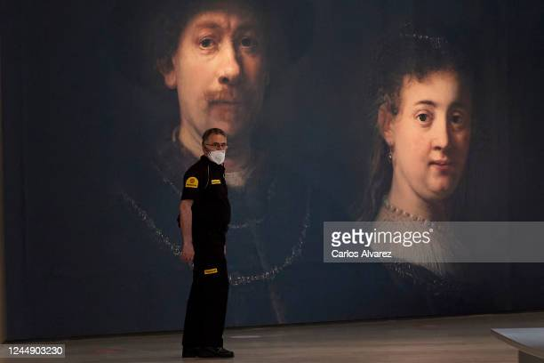 A security guard with a face mask is seen at the entrance of Rembrandt exhibition at ThyssenBornemisza Museum during a press preview before its...