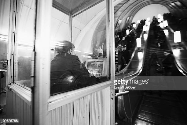 Security guard with videoscreen at escalator at Metro Station Revoljicii Revolution square on October 14 2009 in Moscow Russia Moscow is the biggest...