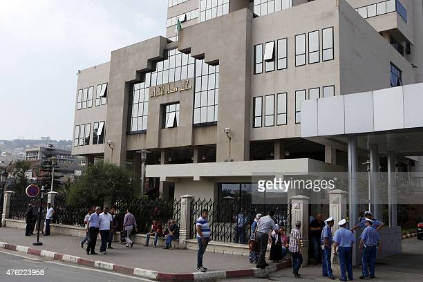 Security guards and people gather outside a criminal court where starts the corruption trial against 19 former executives of state energy giant...