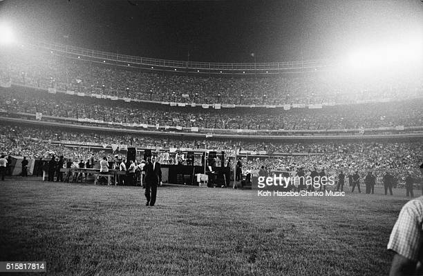 Security guards around the stage as The Beatles play Dodger Stadium Los Angeles California August 28 1966