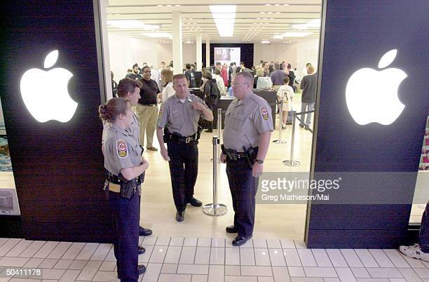 Security guards at entrance of Apple retail store which Apple opened to provide direct sales to consumers of Apple and associated products