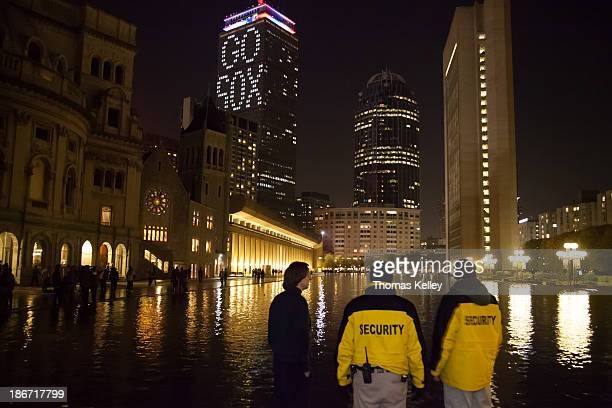 CONTENT] Security guards at the Christian Science Plaza discuss the events of the night In the background the Prudential Tower offers some words of...