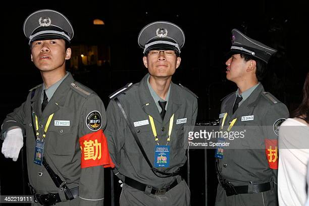 Security guards at the Intro music festival that took place at the 798 Art Zone in Beijing's Dashanzi district.
